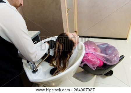 Man Hairdresser Washing Head Client.