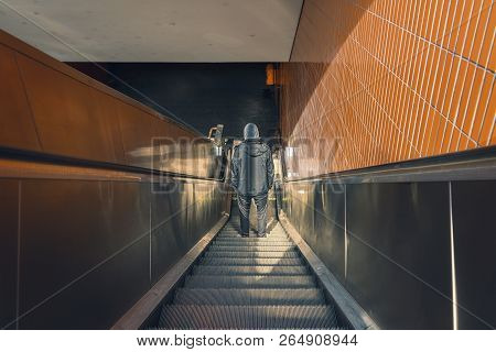Berlin Underground, Back View Of A Young Man On An Escalator