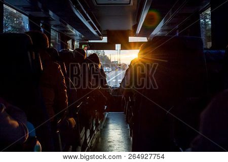 Saloon  Of Bus With Passengers. The Light Of The Sun Penetrates Through The Windshield Of The Bus. F