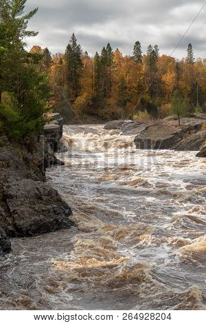 Scenic Autumn Woods Along The Rushing Rapids Of The St. Louis River At Jay Cooke State Park In North