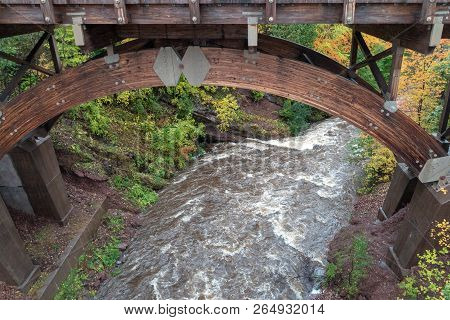 Scenic Bridge At Eagle River Falls In Autumn