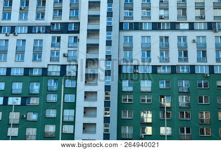 The Green Facade Of The Building With Windows, View Of The Residential Building, High-rise Building,