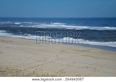 Sunny Day Scene At The Beach On The Shoreline Of Atlantic Ocean