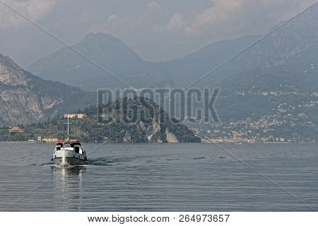Ship Is Coming From Bellagio At Lake Como With Alps Mountains In Background - Italy.