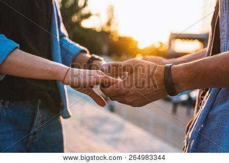 Lovely Young Hipster Couple Dating During Summer Sunset.