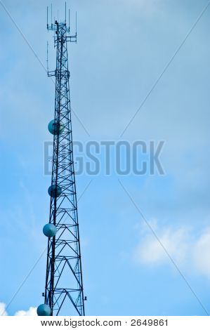 Cell phone and tv communications mast with cloudy blue sky copy space poster