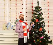 Santa Claus with happy face near bureau and Christmas tree poster