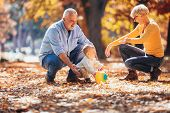 Grandparents and grandson together in autumn park poster