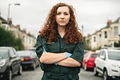 Portrait of female paramedic in uniform poster