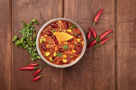 A Photo Of Chili Con Carne, A Traditional Mexican Dish With Red Beans, Cilantro Leaves, Ground Meat,