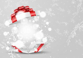 Opened White Gift Box With Red Bow And Lights On Snowflake Background