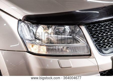Beauty Clean Headlights Of Beige Suv. Close Up  Of Modern  Car Xenon Lamp Headlight