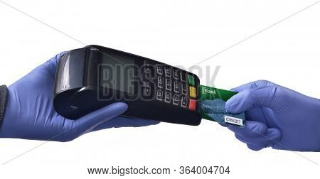 Holding card payment reader using medical latex protective gloves.