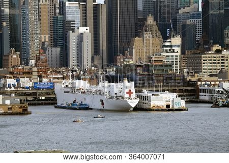 New York, New York/usa - April 25, 2020: Navy Hospital Ship Comfort Docked At Pier 90 To Assist Duri