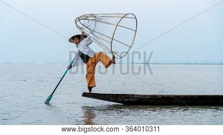 Nyaungshwe, Myanmar : March 12, 2020 - Fisherman Pose For A Picture Inle Lake. Once An Old Tradition