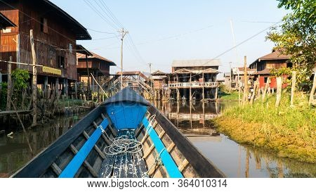 Nyaungshwe, Myanmar : March 12, 2020 - Longtail Boat Ride Inle Lake Canal In Small Rural Village Wit