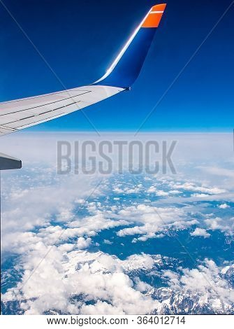 Wing Of Airplane In The Sky Red Winglet Blue Sky Clouds