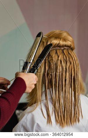 Hair Stylist Makes False Dreadlocks. Process Of Creating Trendy Modern Hairstyle. Cheeky Image. Ethn