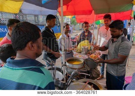 Cuttack, Odisha, India - 24th July 2019 : Dahi Bara Alu Dum Is Being Sold By Roadside Seller To Cust