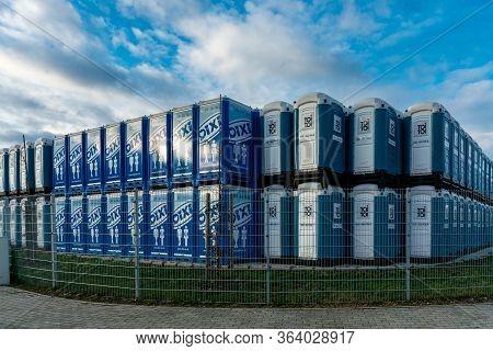 Dallgow-doeberitz, Brandenburg, Germany - February 08, 2019: A Stack Of German Porta-potties (dixi L