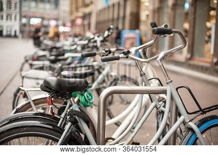 Group Of Lot Of Bicycles Row Parked At Parking Station
