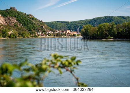 River Danube And Duernstein With The Kuenringer Castle And Blue And White Tower Of The Abbey Church