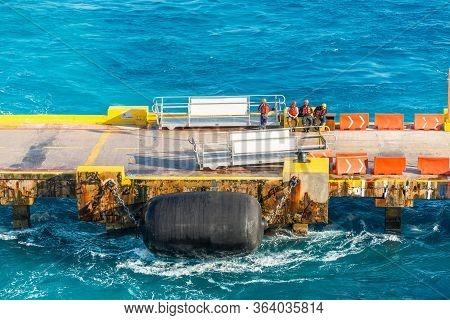 Costa Maya, Mexico - April 25, 2019: Mooring Gang And Port Workers Awaiting Mooring Operation In Por