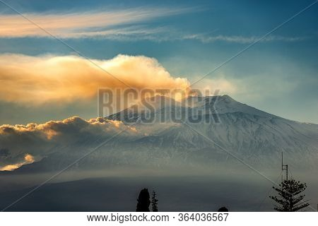 Mount Etna Volcano With Smoke And Snow In Winter At Sunset. Catania, Sicily Island, Italy, Europe