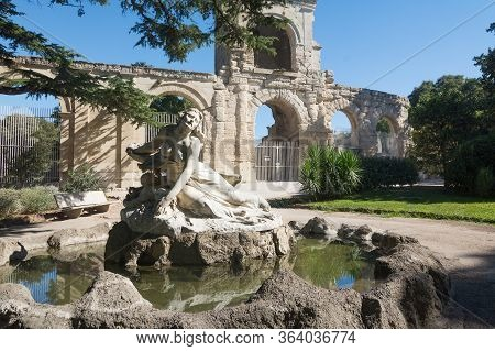 Arles,france-august 14,2016:people Stroll In The Square Where The City Hall And The Obelisk Of Arles