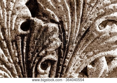 Closeup Image Of Granite With Intricate, Leafy Carvings That Swirl.