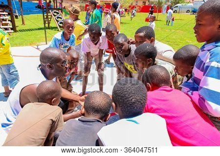 African Children Doing A Sports Team Huddle On Basketball Court