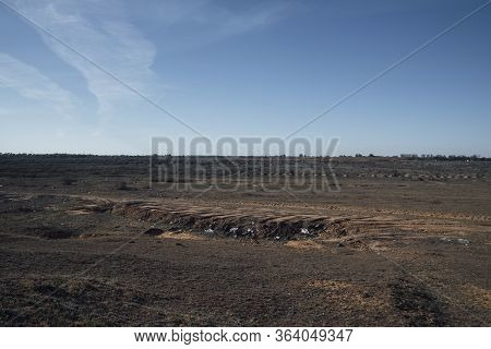 Unauthorized Dumping Of Garbage In The Steppe.environmental Disaster