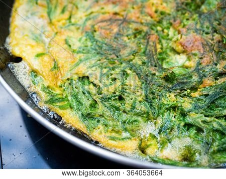 Omelet In Cha Om While The Oil Is Boiling Cha-om Is A Pungent Vegetable.high Nutritional Value