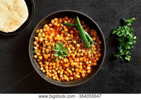 Crispy Roasted Chickpeas. Indian Style Dish Over Black Stone Background. Vegetarian Vegan Food Conce