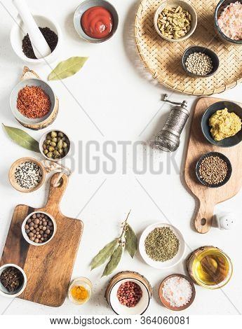 Frame Of Various Dry Spices And Sauces On A Light Background. Flat Lay Of Small Bowls With Dijon Mus
