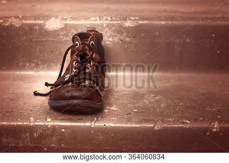 One Old Thrown Shoe On The Stairs. The Concept Of Old Age And Loneliness. Copy Space.