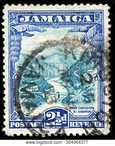 Luga, Russia - April 10, 2020: A Stamp Printed By Jamaica Shows View Near Castleton Saint Andrew, Ci