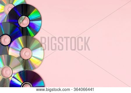 Music Cds Dvds Flat Lay On Pink Background Top View With Copy Space. Creative Design 80-s Style. Rec