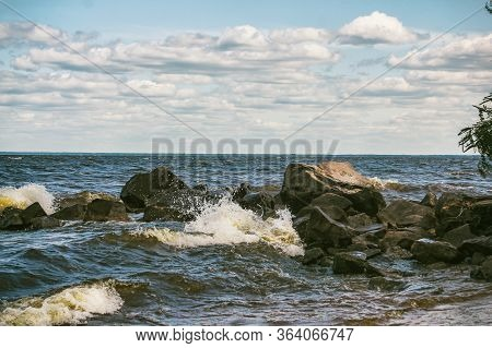 Vintage Style Image Of Large Boulders, Rocks And Pebbles At Low Tide On Rocky Shore. Large Pebbles O