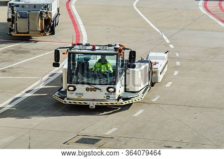 Airport Baggage Tractor At Amsterdam Airport Schiphol In Amsterdam, Netherlands