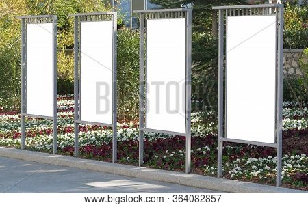 Vertical Billboards For Commercial Advertisements Standing By City Park