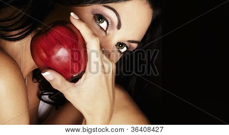 Exotic woman holding red apple