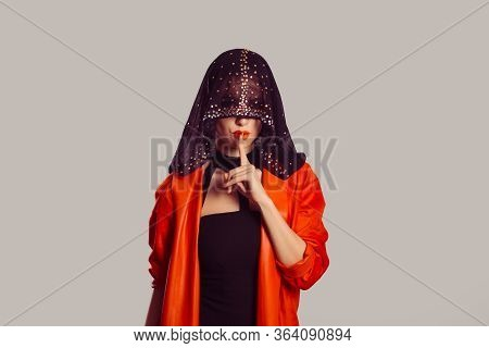 Hush. Woman In Black Veil Index Finger On Lips Asking For Silence Or Secrecy, Shh Hand Gesture Grey