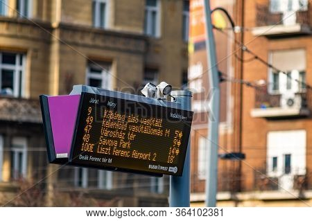 Budapest / Hungary - October 20, 2018: Digital Bus Stop Timetable Display Board Announcing Bus Sched