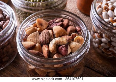 Mixed Nuts In A Glass Storage Container.