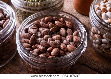 Pinto Beans In A Glass Storage Container.