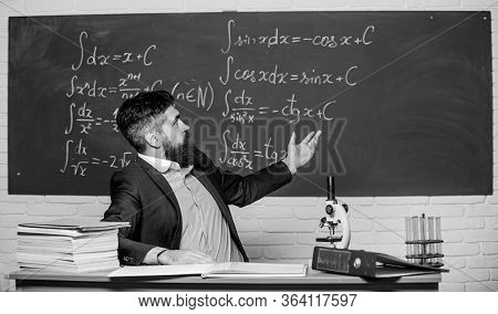 Teaching And Education. University Teacher Use Teaching Aids. Bearded Man Teaching Chemistry In Scho