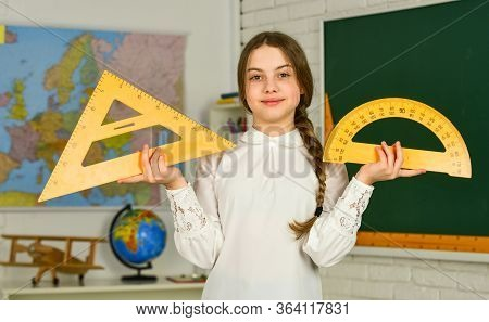 Geometry Favorite Subject. Measure Angles In Degrees. Small Child Girl Use Protractor And Triangle F
