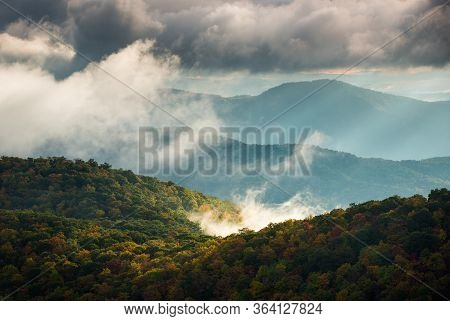 Sunrise Over The Autumn Morning Fog From East Fork Overlook Along The Blue Ridge Parkway In The Appa