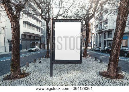 Mockup Of An Empty Information Poster In Urban Settings Near City Roads; A Blank Vertical Street Ban